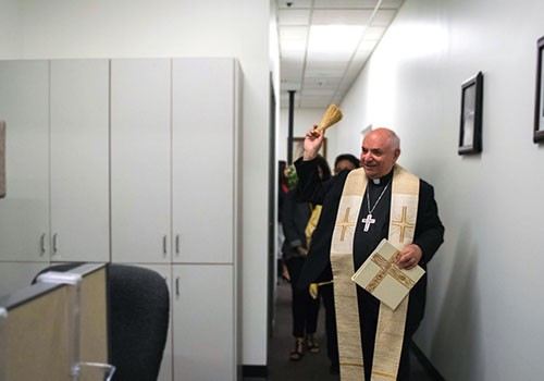 Bishop Barnes blesses remodeled offices at Pastoral Center